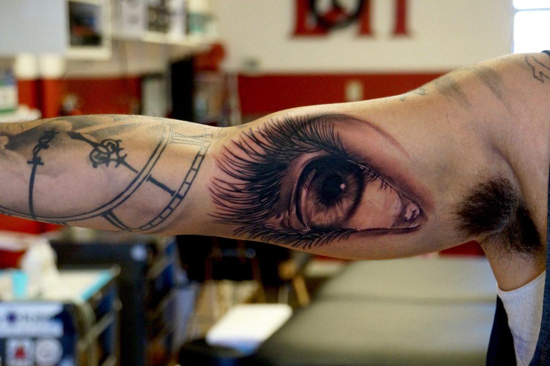 Photo realism eye tattoo love n hate for Love n hate tattoo